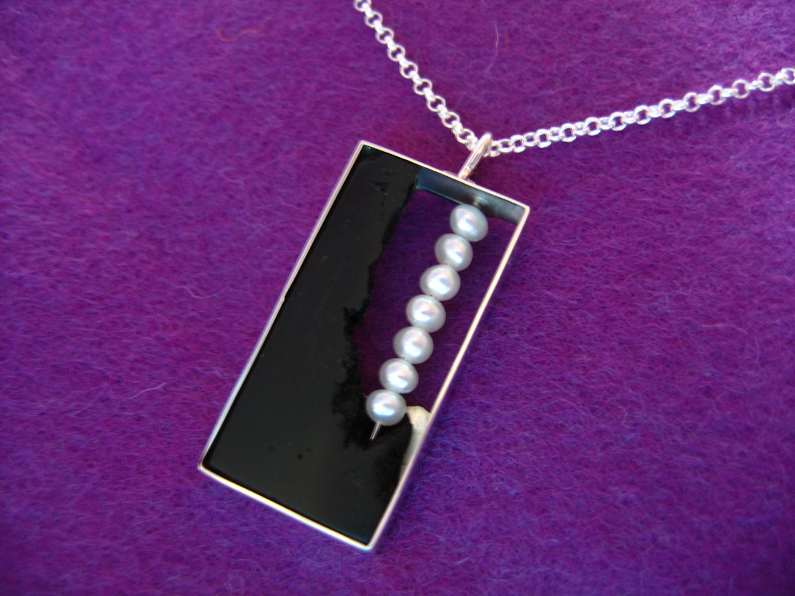 zilver, ebbenhout en parels - 2009